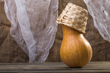 Gourd with wicker basket