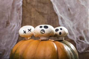 Three champignons on pumpkin top