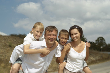 Happy family near mountains
