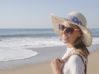 happy fashion blonde girl smiling portrait in the beach, wearing hat and sunglasses, profile photo