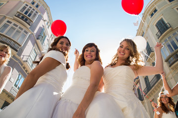 Brides with balloons in hands