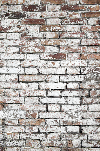 Old large red brick wall background distressed with white paint. Old large red brick wall background distressed with white paint
