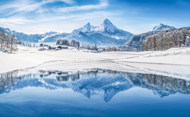 Wall Mural - Winter wonderland in the Alps reflecting in crystal clear mountain lake