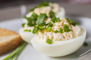 Boiled eggs with mayonnaise and sliced chive