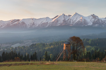 Hunting tower with Tatra mountains in the background early morning