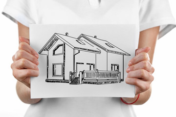 Real estate offer. Woman holding the house picture