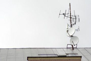 Antennas and satellites on the roof of the house