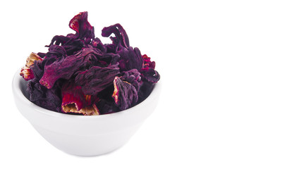 Dried hibiscus went into a white porcelain bowl