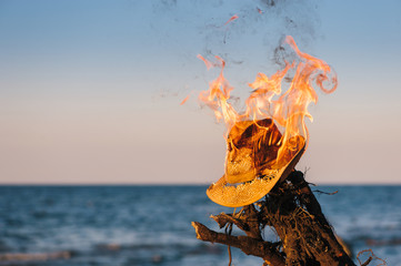 Burning of wicker hat