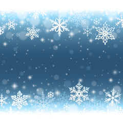 Abstract blue winter background with falling snowflakes and snow