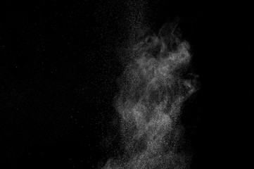 abstract white dust explosion  on a black background. abstract white powder. design elements. abstract texture.