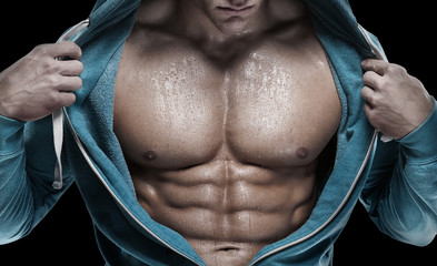 Strong Athletic Man showing six pack abs. closeup