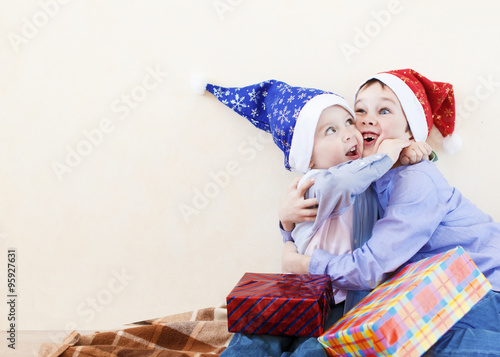 brotherly hugs at Christmas. two funny brothers happy to receive ...