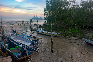 Fishing boats on mud at low tide