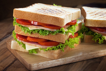 sandwiches on wooden board
