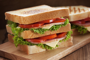 sandwiches put on wooden board
