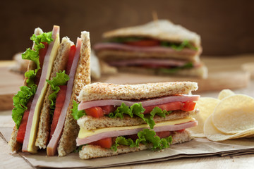homemade club sandwich with potato chip
