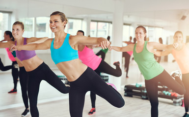 Young women working out in aerobics class