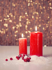 Candle and berries on snow
