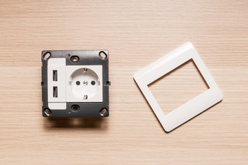 The socket with two usb-charger ports, without decorating pane.