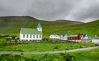 Small village church with cemetery in Gjogv, Faroe Islands, Denmark