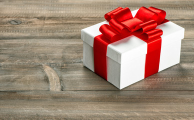 Gift box with red ribbon bow. Holidays decoration