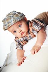Happy baby in a cap
