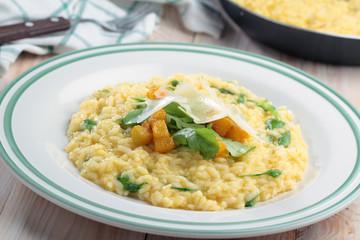 Pumpkin risotto with arugula and Parmesan cheese
