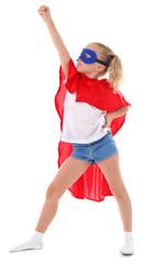 Beautiful blonde superhero little girl poses in studio isolated on white background