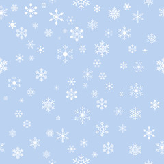 seamless white snowflakes on blue background for christmas, new year