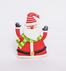 small toy of santa claus in red hat and scarf isolated on white