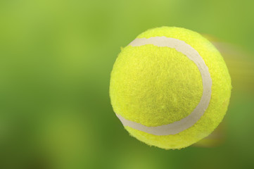 Lawn Tennis Ball in Motion on Green Background