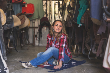 Pretty girl posing in equestrian context