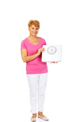 Smiling old woman holding weight scale