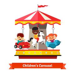Kids having fun on a carnival carousel