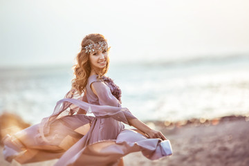 Portrait of a girl in a fairy light dress on a sunset