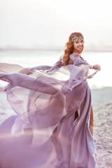Portrait of a girl in a fairy light dress is walking