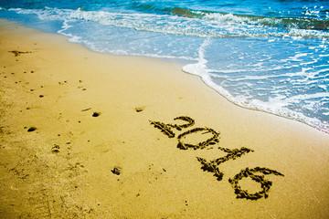 2016 written on the sand