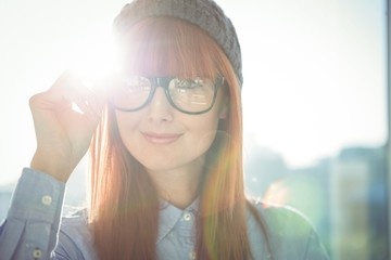 Portrait of smiling hipster woman posing