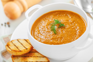 Bowl of lentil cream soup with toasts for lunch
