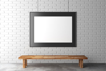 Blank picture frame on brick wall with wooden bench on concrete