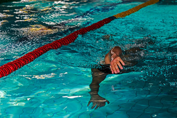 Athletic swimmer in action 2