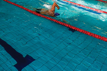 Athletic swimmer in action 1