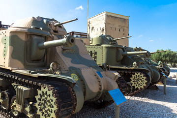 Old American medium tanks on display from the left M3 Grant, M3 Lee and M3A1 Stuart