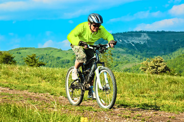 Biker rides at mountain road