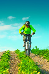 Cyclist rides downhill from mountain