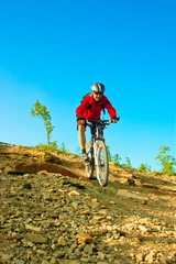 Senior cyclist  rides downhill from mountain