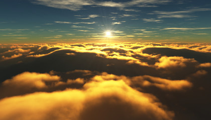 View of a cloudy sunrise while flying above the clouds.