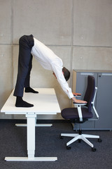 short break for yoga in the office - caucasian male professional exercising