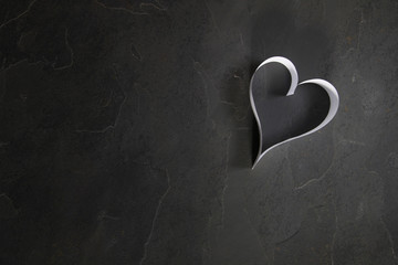 Fototapeta Serce z papieru na kamiennym tle obraz